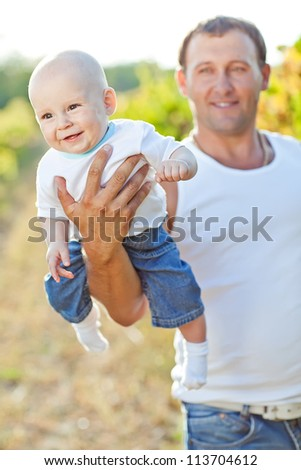 father and baby nature - stock photo