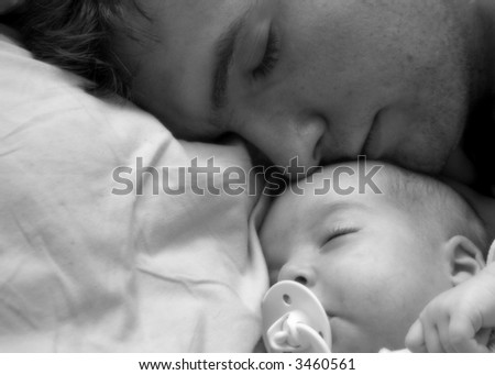father and baby sleeping - stock photo