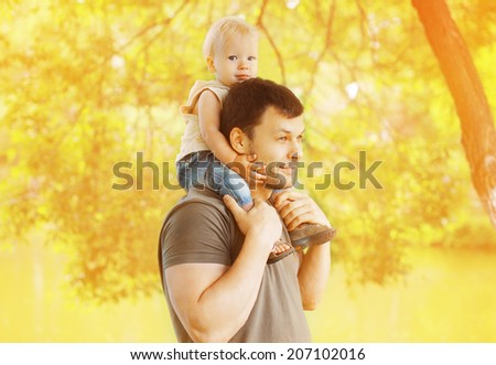 Father and child walking in the park - stock photo