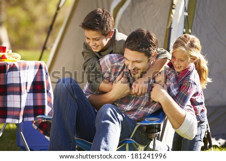 Father And Children Enjoying Camping Holiday In Countryside