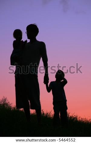 father and children on sunset - stock photo