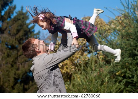 Father and daughter against nature - stock photo