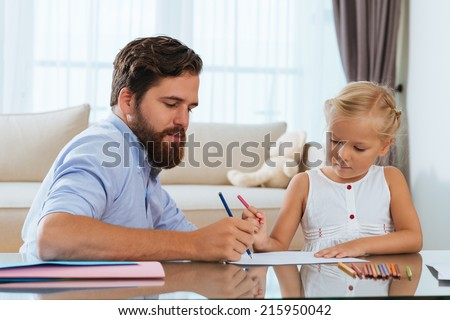 Father and daughter enjoying drawing together - stock photo