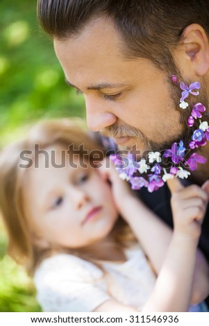 Father and daughter happy time in nature - stock photo