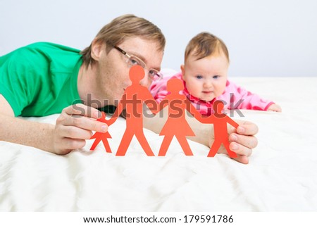 father and daughter holding paper family, family concept - stock photo
