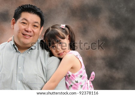 father and daughter holding, studio shot - stock photo