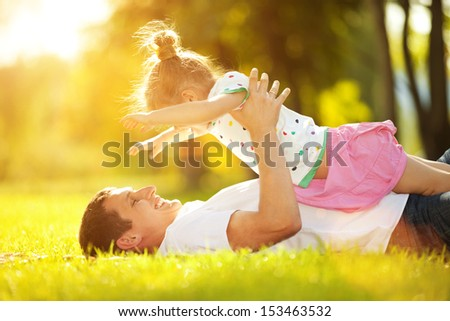 father and daughter in the park - stock photo