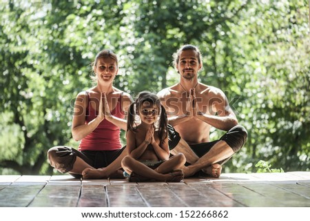 father and daughter on the morning gymnastics. - stock photo