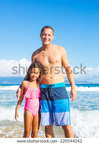 Father and Daughter on Tropical Beach Vacation - stock photo