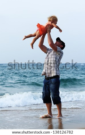 father and daughter on vacation at sea - stock photo