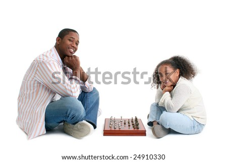 Father and daughter playing chess over white background. - stock photo