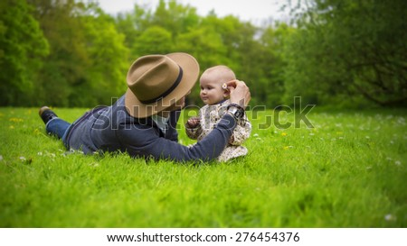 Father and daughter playing in the park - stock photo