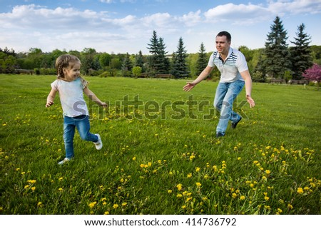 Father and daughter running and playing together