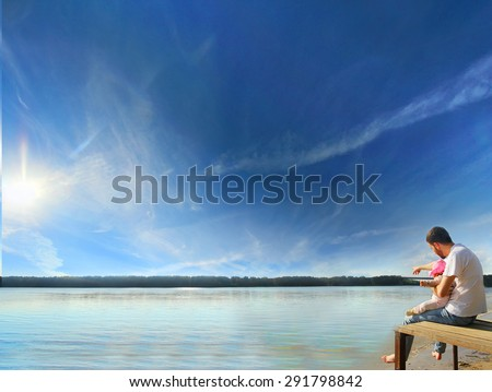 Father and Daughter sitting Together at the riverside with sun counter light. family and father's day concept - stock photo