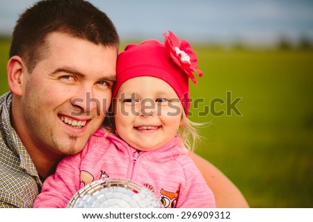 Father and daughter smiling close-up portrait. Disco Ball Child with hands