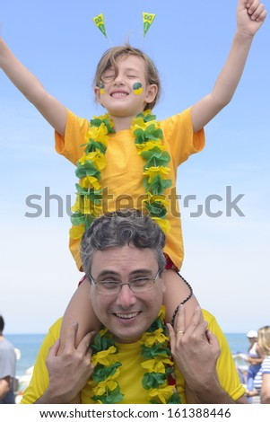 Father and daughter soccer fans of Brazil. - stock photo