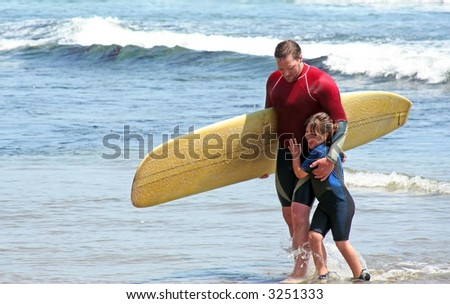 Father and Daughter Surfers - stock photo