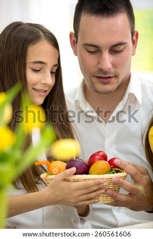 Father and daughter with colorful Easter eggs - stock photo