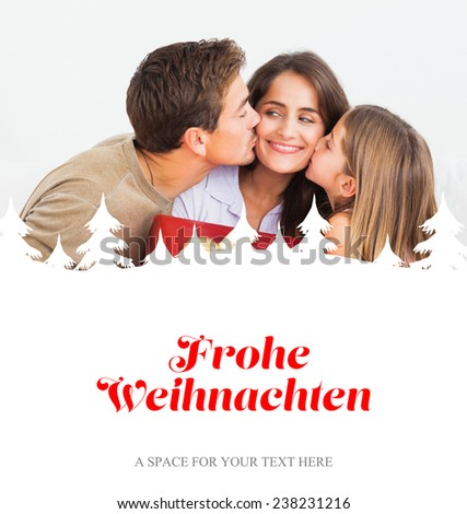 Father and his daughter offering a red gift against christmas greeting in german - stock photo
