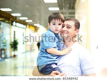 Father and his little child doing shopping - stock photo