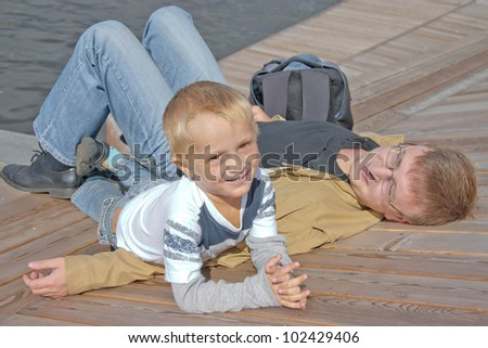 Father and his little son having rest outdoor - stock photo