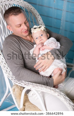 Father and his newborn daughter. family portrait - stock photo