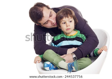Father and his pained son over white background - stock photo