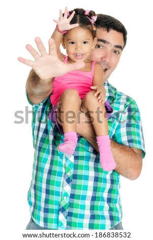 Father and his small daughter waving their hands and greeting at the camera (isolated on white) - stock photo