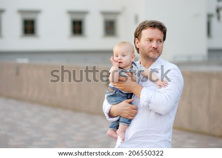 Father and his son in a European city  - stock photo