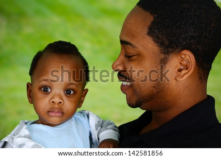 Father and his son playing outside together - stock photo