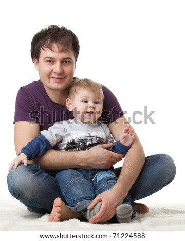 Father and  his sweet  baby on a white background.  Happy family. - stock photo