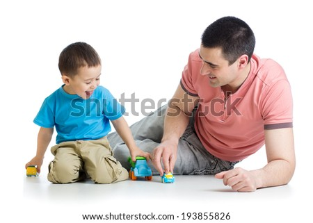Father and kid play with car toys together - stock photo