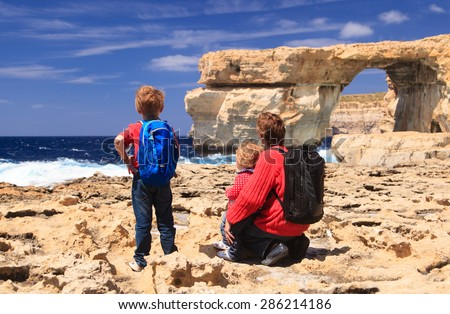father and kids looking at Azure Window on Gozo island, family travel