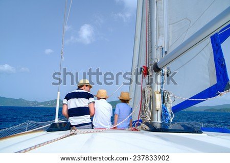 Father and kids sailing on a luxury yacht or catamaran boat - stock photo