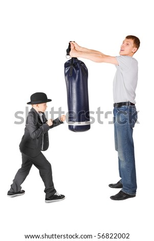father and little boy wearing gangster suit. father is holding punching bag. - stock photo