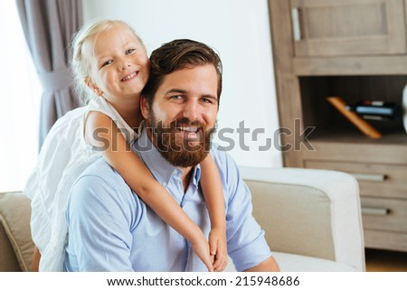 Father and little daughter enjoying their time at home - stock photo