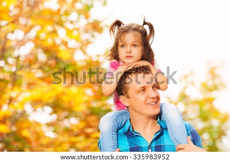 Father and little daughter on shoulders