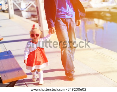 father and little daughter walking in the port, family travel