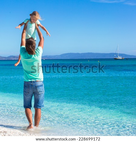Father and little girl enjoy summer vacation