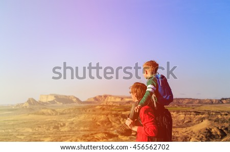 father and little son travel in mountains