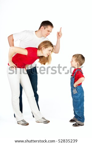Father and mother scold and shout at their son - stock photo