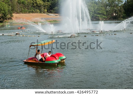 father and play water bike boat - stock photo