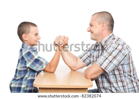 Father and son arm wrestling for fun, isolated on white background - stock photo