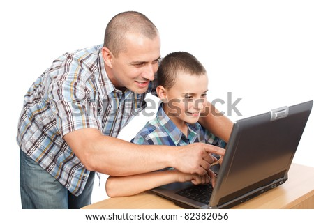Father and son at the laptop, isolated on white background - stock photo
