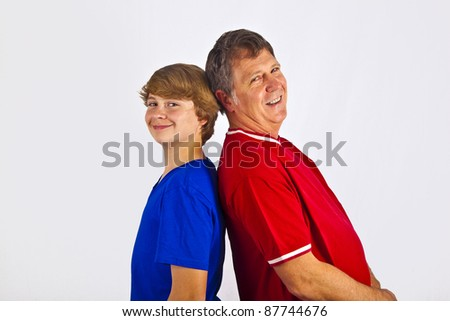 father and son back to back - stock photo