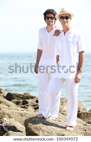Father and son by the seaside - stock photo
