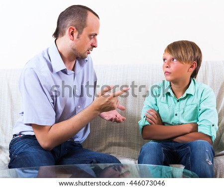 Father and son discussing something serious at home