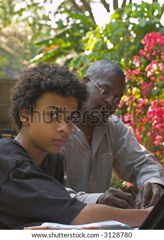 father and son doing homework - stock photo