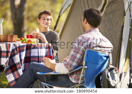 Father And Son Enjoying Camping Holiday In Countryside - stock photo