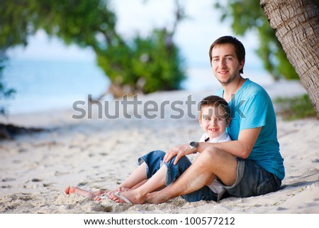 Father and son enjoying time at beach